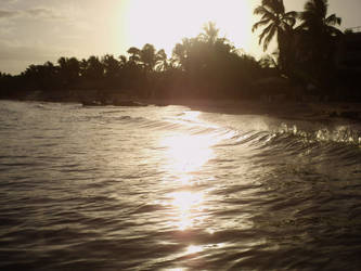 Reflecting sunset on the beach by ElMenor2393