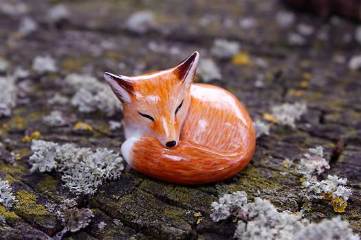 sleeping red fox figurine