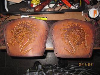 Pair of dragon carved bracers by akinra-workshop