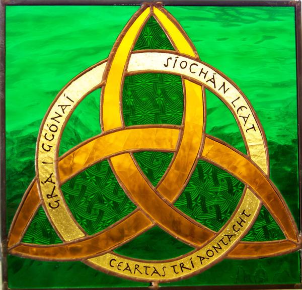 Black ink Celtic Knot tattoo. Trinity knot tattoo.