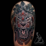 Erwins-black-grey-and-red-tribal-lion-thigh-tattoo