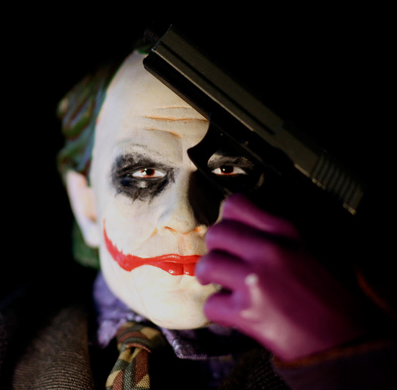 Joker with gun by Dyslexic-Ferret