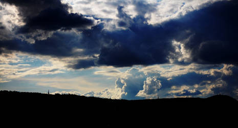 Puffy skies by KreatO123