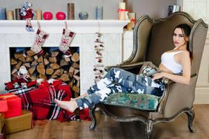 Christmas Lara Croft cosplay - sitting by TanyaCroft