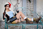 Christmas Lara Croft cosplay - on the bench