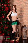 Christmas Lara Croft cosplay - brick wall