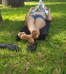 Reading on the park by lightxyz