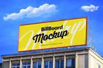 Free Billboard On Building Mockup PSD by Designbolts