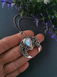 Lunula pendant with rainbow moostone