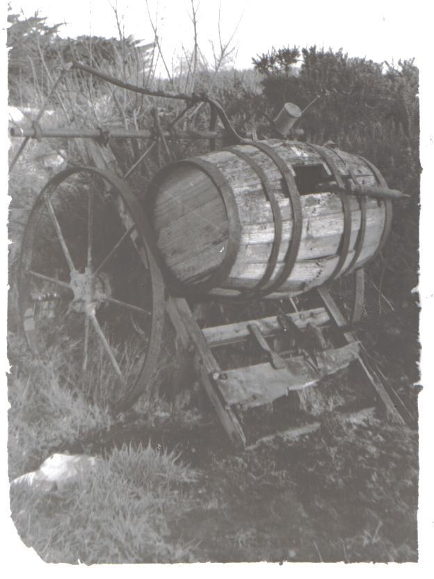 an old cart and barrell