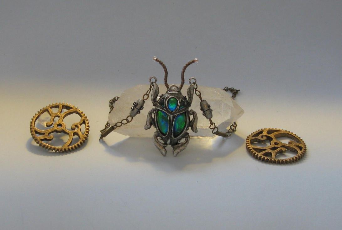 iridescent steampunk scarab by bringbackthedodo on deviantart