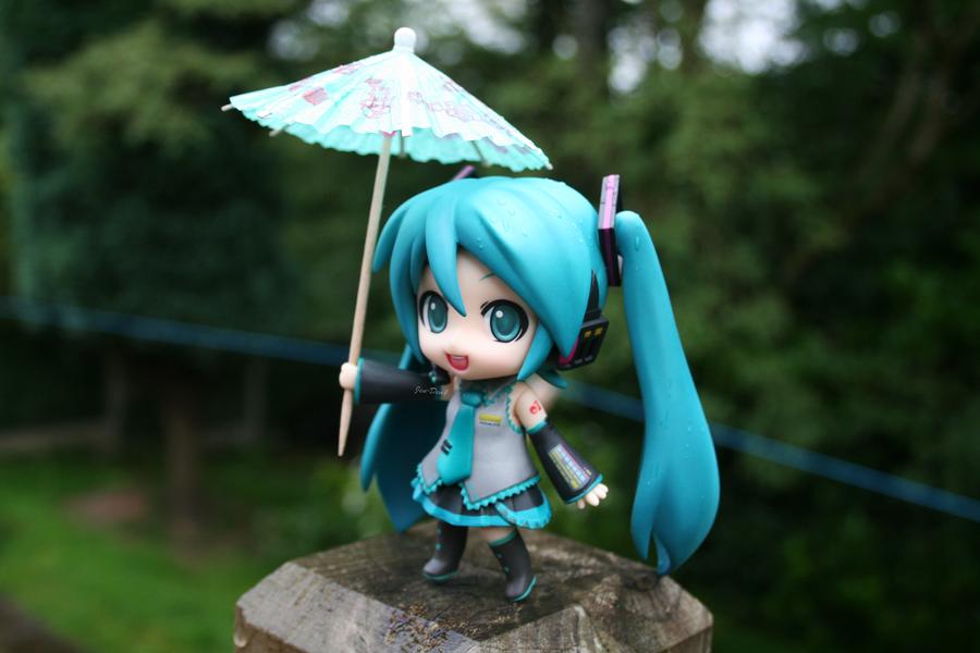 Miku and Her Umbrella by jen-den1