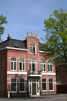 Red-bricked House with letters PTB