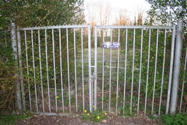 Galvanized Gate Entrance to Fallow Terrain
