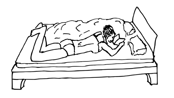 Woman reading on a bed by sneakys
