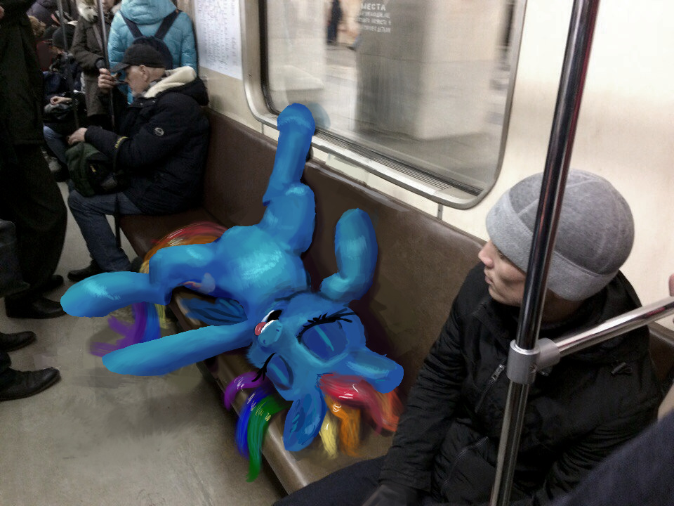Rainbow Dash is sitting in the subway train photo