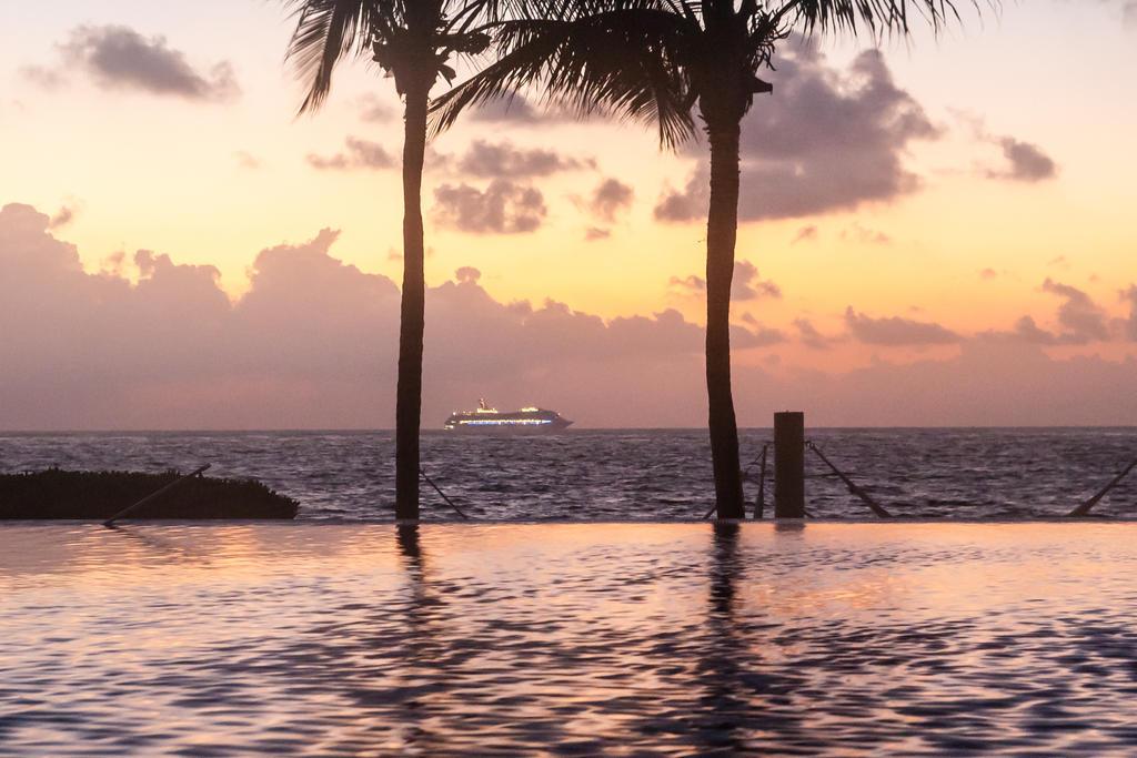 Cruising Past Cancun by AngusMacRath
