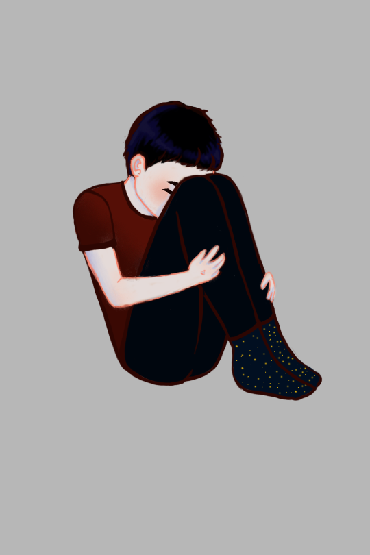 A pale person sitting with their face hiding behind their knees