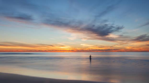 Mission Beach Mann im Wasser