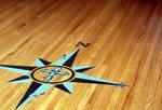 Compass on wood floor