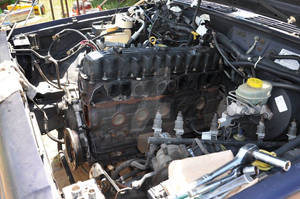 1998 Jeep engine intake and exhause headers remove