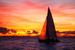 Yacht sailing at sunset by RomGams