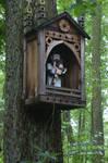 wayside shrine on tree