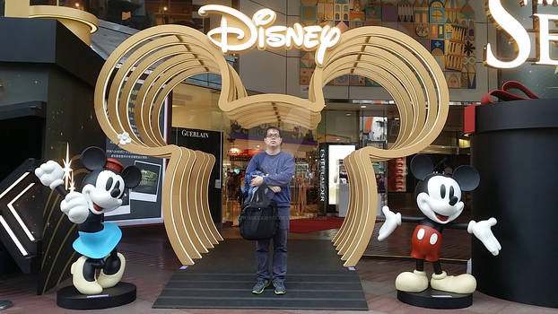 Me at a Disney Logo with Mickey and Minnie