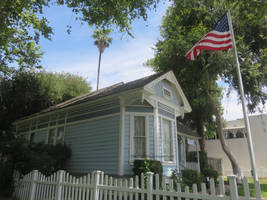 American Flag and a Little Blue House