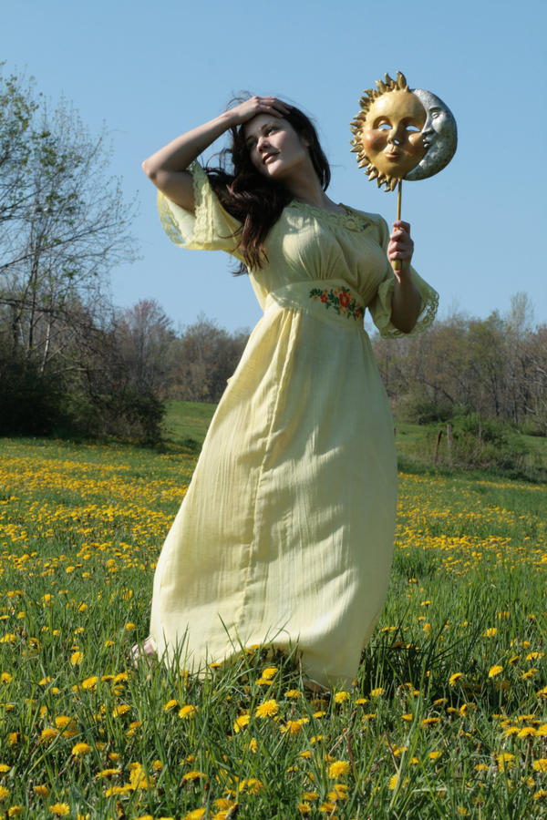 yellow sun dress hand on head by eyefeather-stock