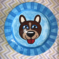 dog painting on plate.