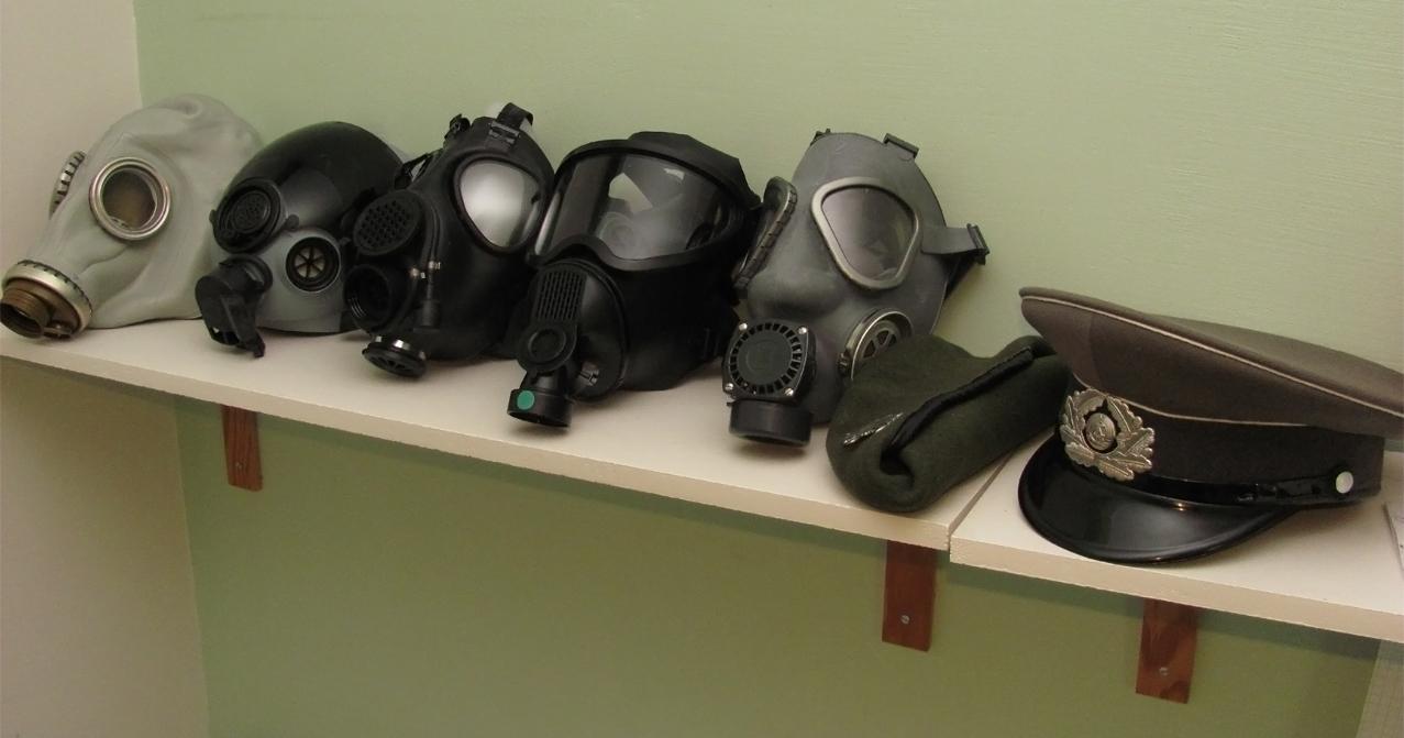 Row of Gasmasks by Nirwrath
