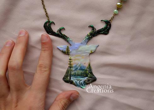 deer necklace with landscape