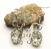 White Topaz Earrings by skezzcrom