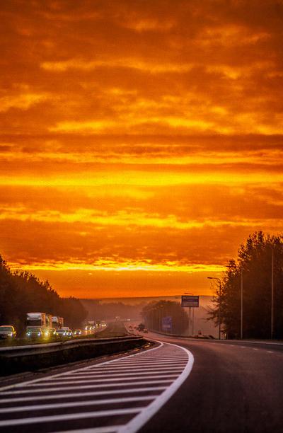 Sunrise on the autobahn by ralucsernatoni
