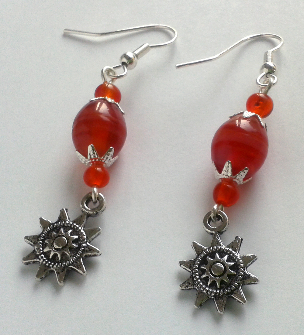 red glass pearls with silver sun filigrees by syn-O-nyms