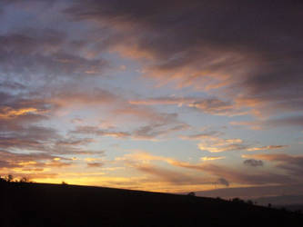 Clouds at sunset time by rimolyne