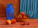 With apples and a vase