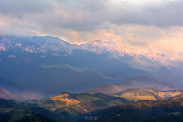 Sunset over the misty mountains