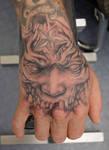 monster hand tattoo