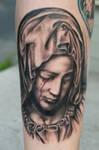 crying virgin mary tattoo