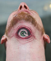 an eyeball tattoo by graynd