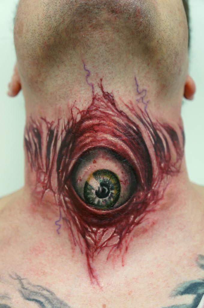 an eyeball tattoo by graynd