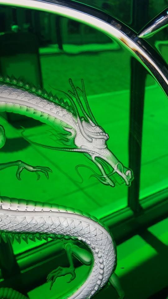 Green window dragon by Viczan