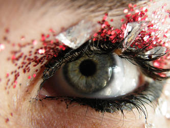 Eye red sparkles and glass by music-lover-stock