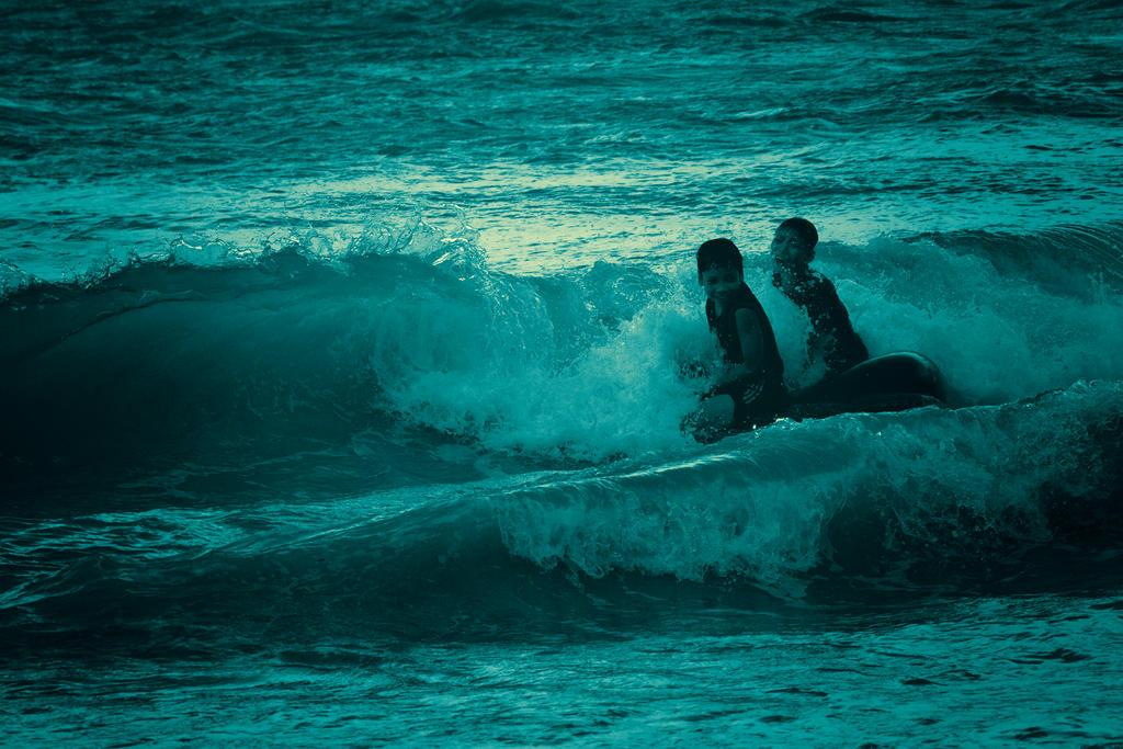 Playing on the beach by muhadi65