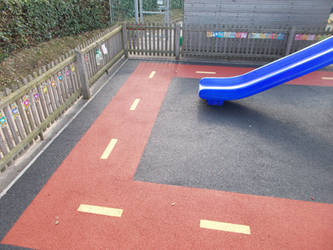 Wetpour play area surfaces installation by PlaygroundMarkings