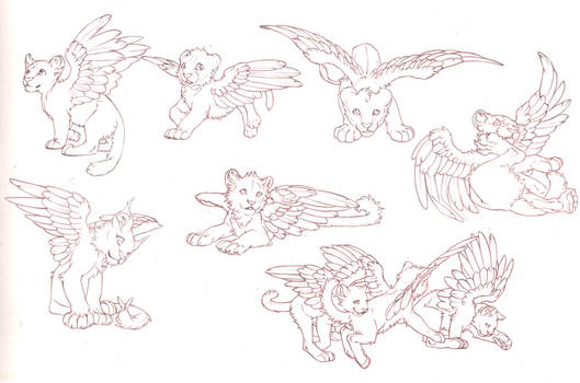 Pencil sketches of winged kittens