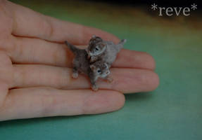 Baby Otters Handmade Miniature Sculptures by ReveMiniatures