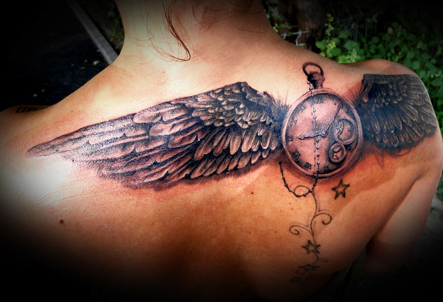 time fly tattoo on back by virlaneduard